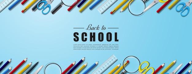 長方形の背景に学用品が並んでいる学校に戻る
