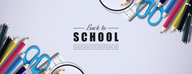 직사각형 배경에 학교 도구를 사용하여 학교로 돌아가기