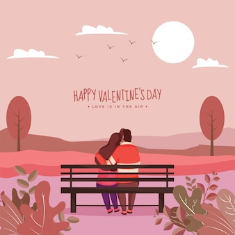 Back view of young lover couple hugging sit on bench with evening nature scene background.