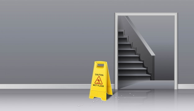 Background of cleaning in progress lift hall and staircase with yellow sign caution wet and bucket of water with a mop.