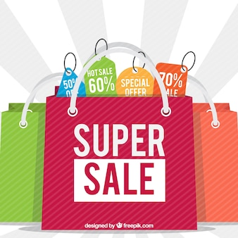 Background of colorful sale bags Free Vector
