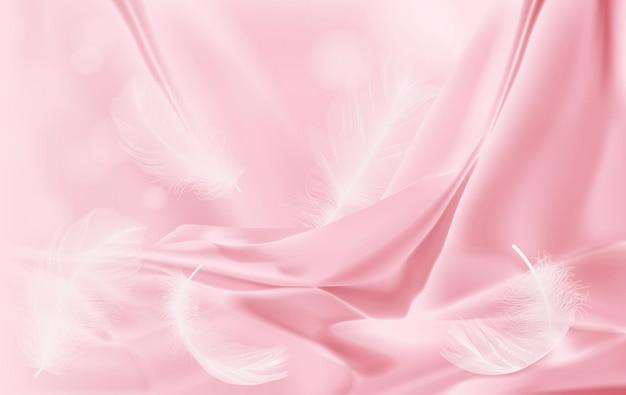Фон драпировка нежный розовый шелк и перья