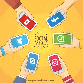 Background of hands holding mobile phones with social networks