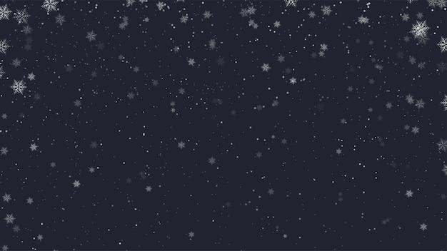 暗い背景の降雪で多くの透明な雪片の背景