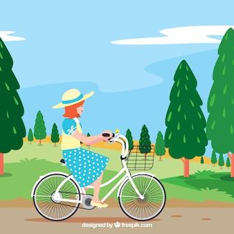 自転車で少女と美しい風景の背景