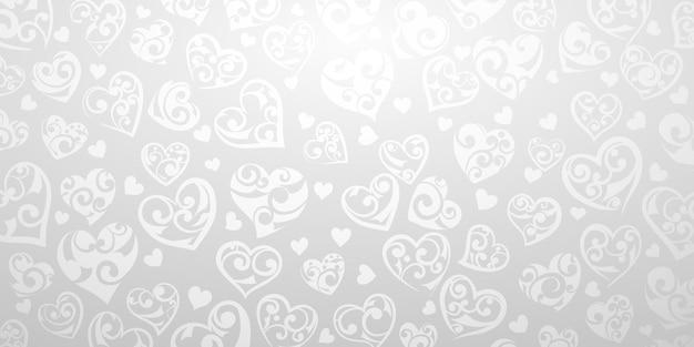 Фон из больших и маленьких сердец с орнаментом из завитков, в серых и белых тонах