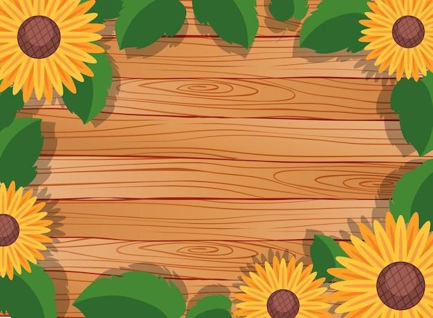 葉とひまわりの要素を持つ空白の木製テーブルの背景