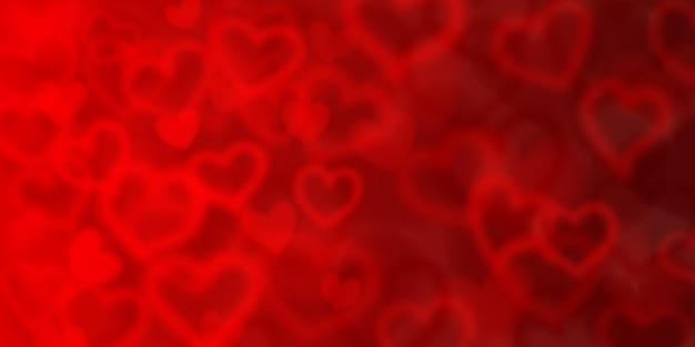 赤い色のぼやけた心の背景。バレンタインデーのイラスト