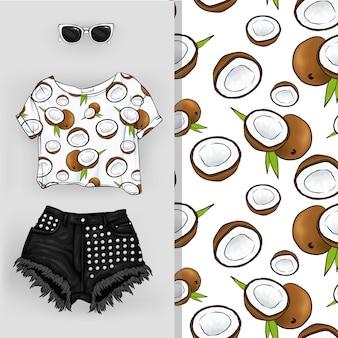 ココナッツの背景。フルーツとショートパンツのショートトップ、フェミニンでスタイリッシュな表情。
