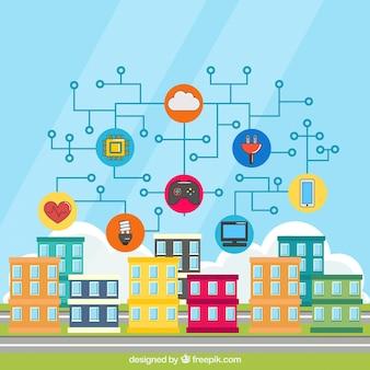 インターネットに接続されたオブジェクトを持つカラフルな建物の背景