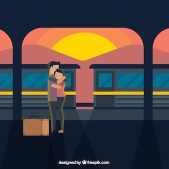 駅への別れを言っているカップルの背景