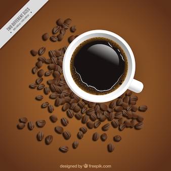 컵과 커피 콩의 배경