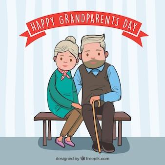 벤치에 앉아 귀여운 조부모의 배경