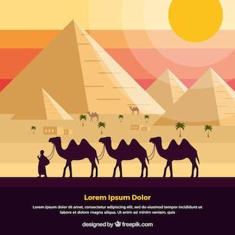 낙타의 캐러밴과 이집트 피라미드 풍경의 배경