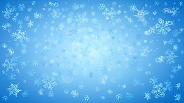 明るい青の背景に白い雪が降る背景