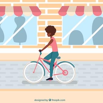 都市の自転車に乗っている少女の背景