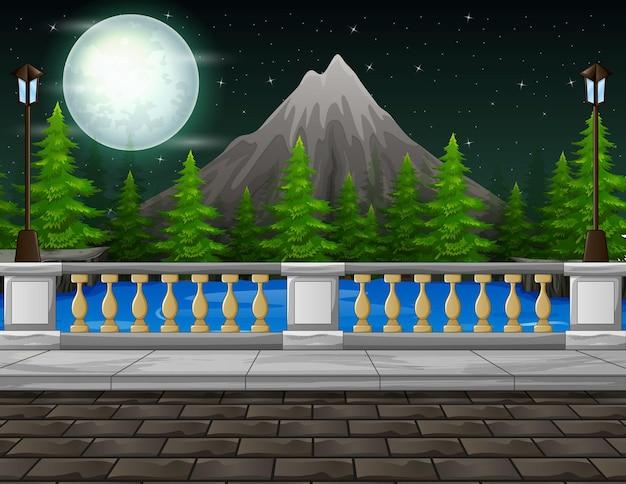 夜の風景の山と道端の背景