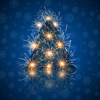 花火で作られたクリスマスツリーと雪片の背景