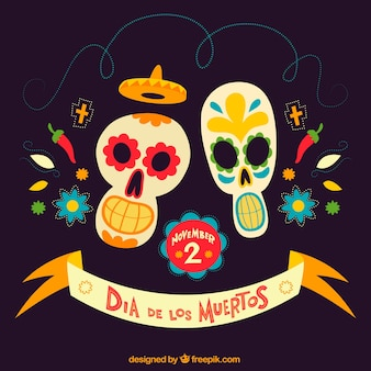 Background of the day of the dead with mexican skulls