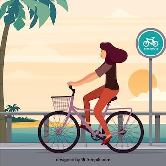 자전거와 함께 걷는 여자의 배경
