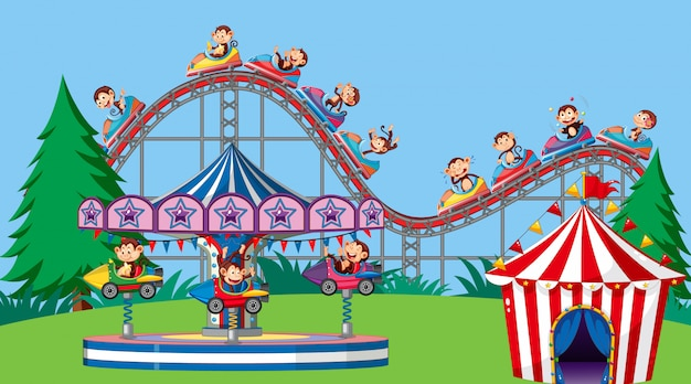 Background scene with happy monkeys riding rides in the park