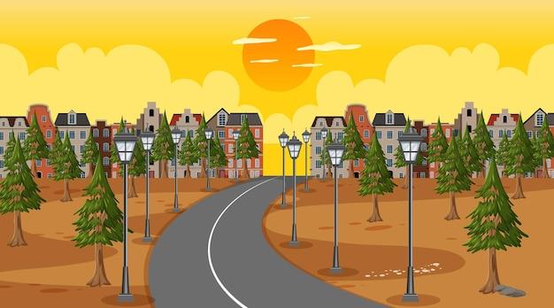Фоновая сцена с длинной дорогой через парк в город во время заката