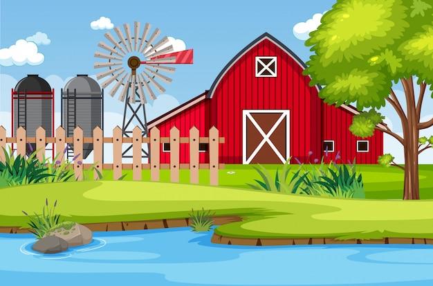 Фоновая сцена с красным сараем и ветряная мельница на ферме