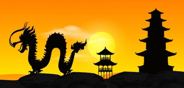 석양 실루엣 중국 용과 함께 배경 장면