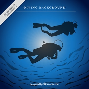 Background of scuba divers silhouettes