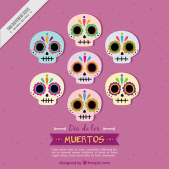 Background of several mexican skulls in flat design