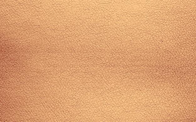 ベージュの天然皮革の背景テクスチャパターン