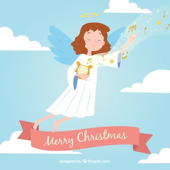 Background with a christmas angel playing harp