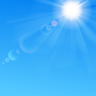 Background with blue sky, sun, rays and lens flare