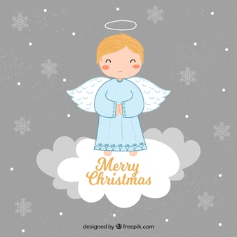Background with a cute christmas angel on a cloud