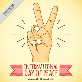Background with hand showing the peace symbol