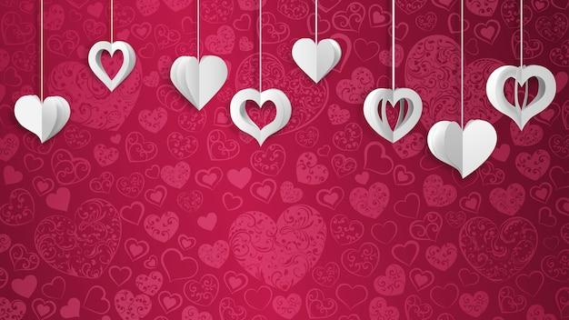 ぶら下がっている紙のボリュームの心と背景、ピンクに白
