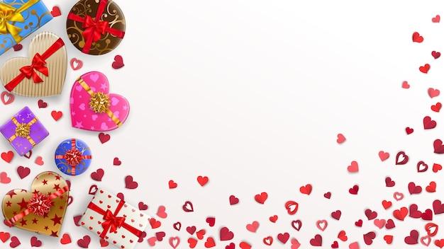 리본, 활, 다양한 패턴이 있는 작은 빨간색 하트와 다채로운 선물 상자가 있는 배경