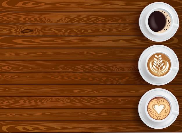 編集可能なテキストのための場所と木製のテーブルトップビューにコーヒー3杯の背景