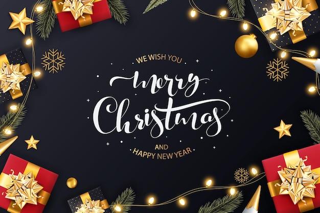 リアルなギフトボックススノーフレークとキラキラと輝くライトガーランドの背景クリスマスデザイン