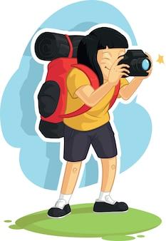 写真を撮るバックパッカーの女の子