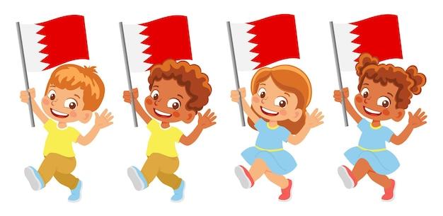 Флаг бахрейна в руке. дети держат флаг. государственный флаг бахрейна