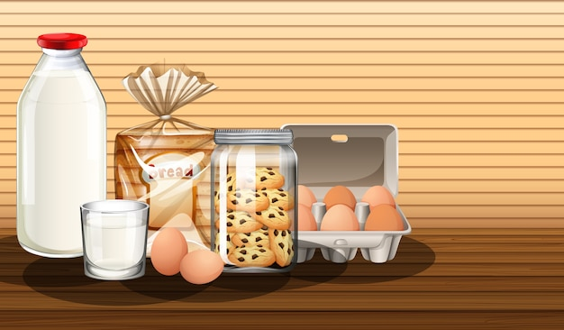 Baked goods with bottle of milk and two eggs in a group