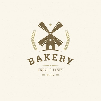 Bakery logo or badge vintage vector illustration mill silhouette for bakery sho