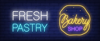 Bakery shop neon sign. Fresh pastry glowing inscription and cookie on brick wall