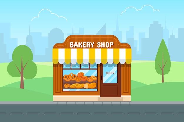 Магазин хлебобулочных изделий в плоском стиле. фасад пекарни. большой город на фоне.