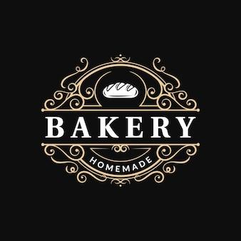 Пекарня винтажный богато украшенный роскошный типографский логотип с процветающим вихревым орнаментом
