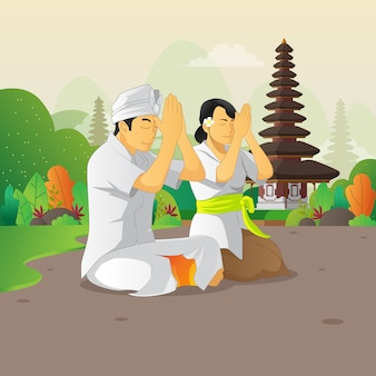 Balinese man and woman praying on the silent day celebration