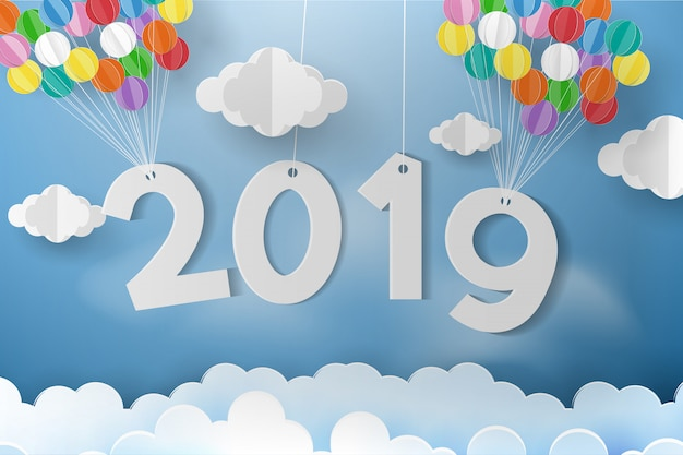 Balloon over cloud with greeting card and new year.
