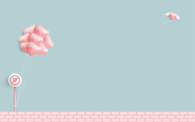 水色の緑の背景にバルーンピンクのハート。