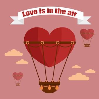 사랑의 풍선은 공기 리본에 있습니다